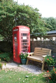 Old phone box now used as village library. (Not a lot of room for browsing.)