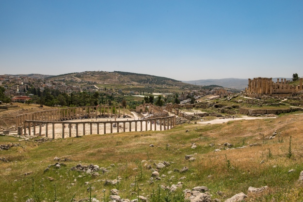 Looking over the ruins towards the modern city on the left. Temple of Zeus on the right. Notice all of the unexcavated land.