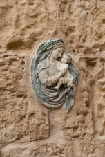Virgin and Child embedded in a house wall.