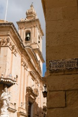 Street sign in English and Maltese.