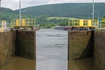 Lock gates opening after lowering the boat