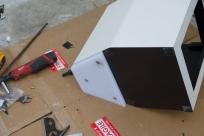 Costco cutting board, repurposed into toilet support.