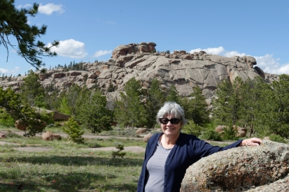 Denise admires the rocks.