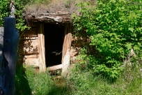 Spring House. The house was built over the spring and the water flows out the front door. Used as a form of refrigerator.